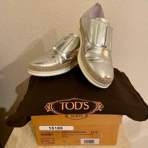 TODS Silver Slip ons
